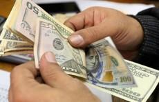 انخفاض طفيف بسعر صرف الدولار الامريكي امام الدينار العراقي