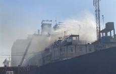 حريق قرب باب قبلة الإمام الحسين في كربلاء (صور)