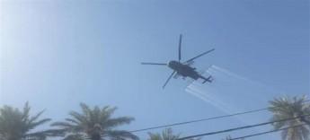 """الطائرات العسكرية تكافح """"الدوباس"""" في كربلاء"""