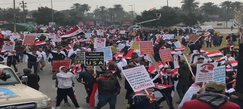 """ردود أفعال متابينة عقب إنتهاء  تظاهرة"""" إخراج القوات الأمريكية"""